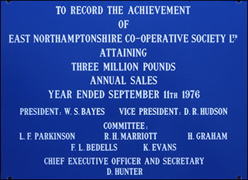 plaque marking three million pounds sales for East Northants Co-op Society Ltd in 1976
