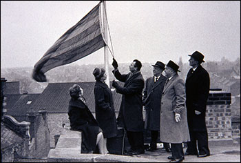 Raising the flag on the Office building
