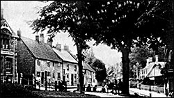 Photograph showing the cottages next to the Wheatsheaf.