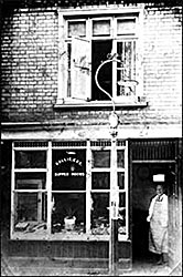 Rollie Cox's shop with him in the doorway