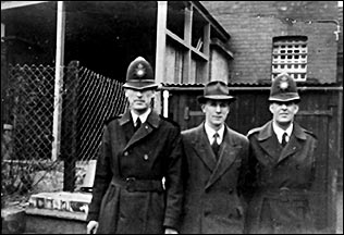 Arthur Evans with two colleagues at the back of Rushden Police Station 1951