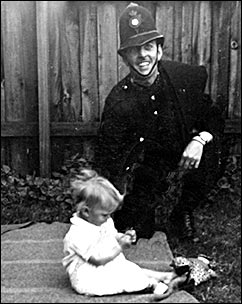 Arthur Evans in his uniform with his daughter in 1947