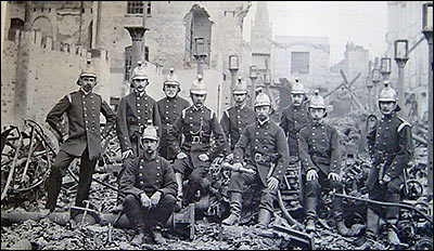 Photograph of Rushden firemen after the fire at Cave's 1901