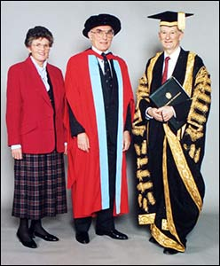 Brian (centre), with his wife Sonia and Lord Dearing