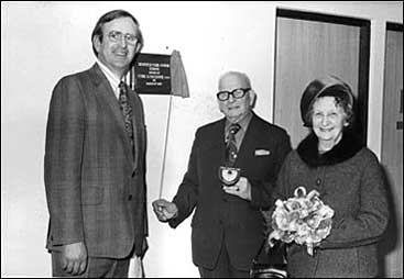 Photograph of cHead Teacher Bob Whitworth and Mr and Mrs Cyril Faulkner unveiling the plaque.