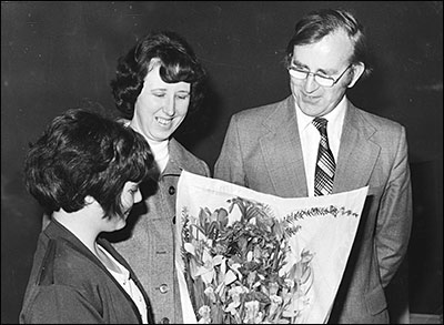 photograph of Bob Whitworth and wife being presented with flowers