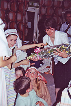 Photograph of Susan Manton presented with a bouquet.