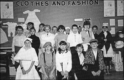 Classroom display and children dressed up for topic on Clothes and Fashion