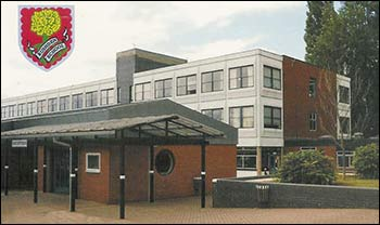 View of Rushden School Reception, and the school badge