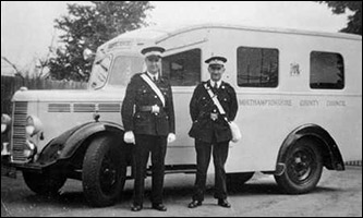 Cliff Iliffe and Bill Houghton with an ambulance