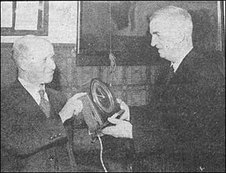 Thomas is presented with the clock
