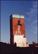 Photograph by Peter Danby showing the tower, with the water tank on top, prior to being demolished
