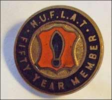 NUFLAT badge