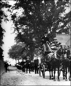 An open carriage with the black horses